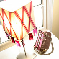 Lampshade with crisscross ribbons and jewels