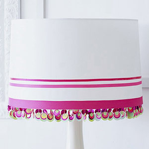 White lamp with pink ribbon stripes and beaded trim