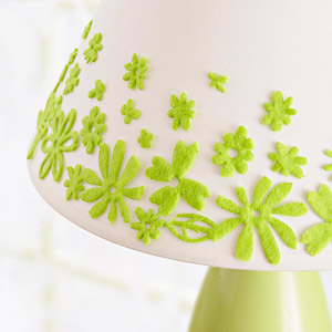 Green lamp with white shade and green felt flowers