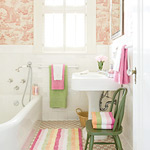 Pink and green bathroom with toile wallpaper