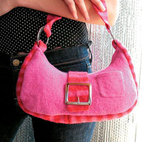 Pink purse made from recycled sweaters