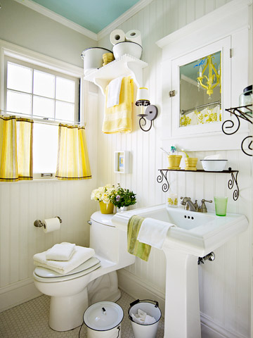 After white bathroom with yellow accents