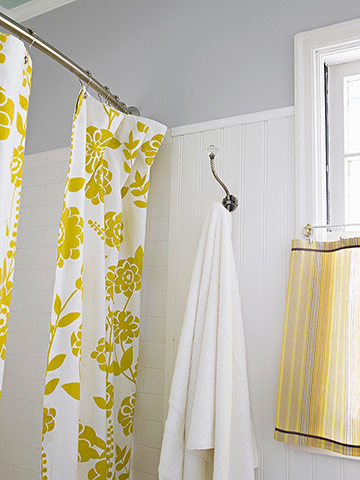 Curved shower rod with yellow curtain