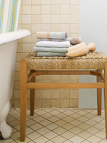 Woven stool with blue towels