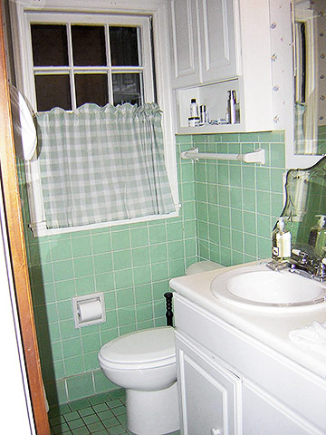 Before green tile bathroom