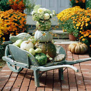 Stacked pumpkins in a wagon