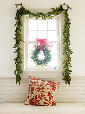 a window with a basic pine garland