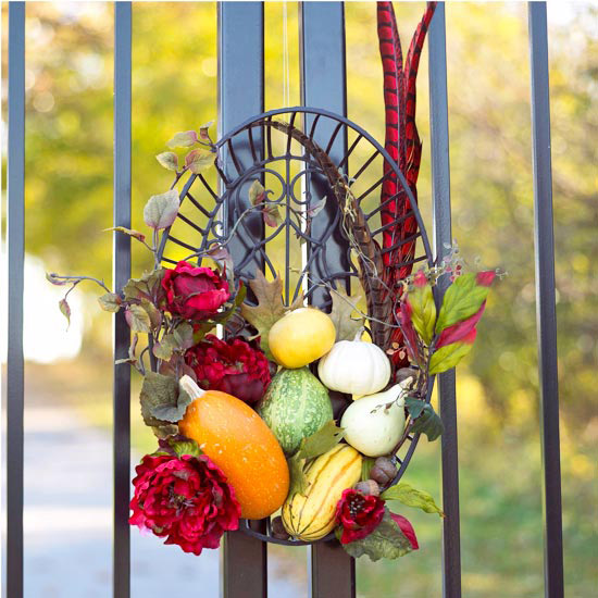 Fall Decoration on the front of a black iron gate