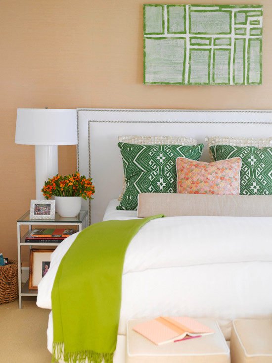 White bedroom with  green and orange accents