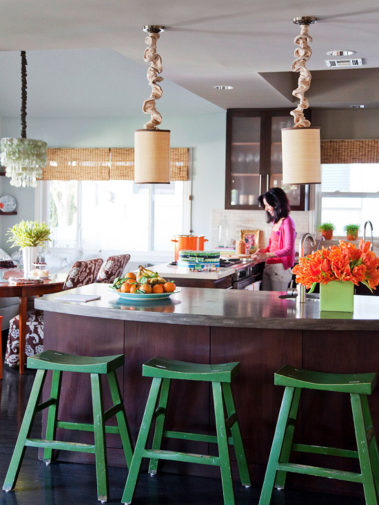 Indoor kitchen with green stools