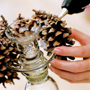 Pinecones being applied to candlesticks