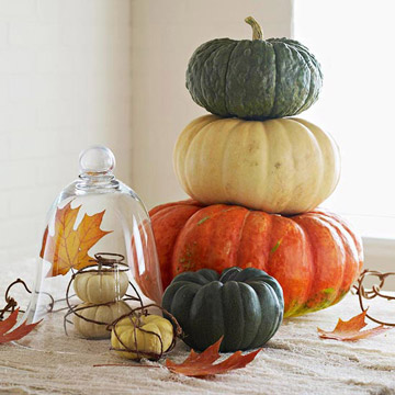 Stacked pumpkins on table