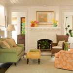 Living room with colorful accents and white walls