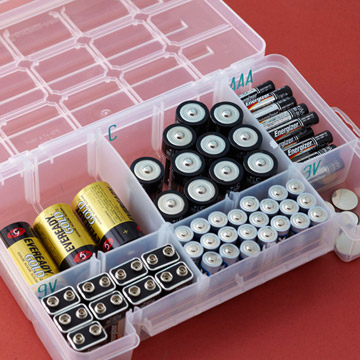 Batteries in a plastic tackle box