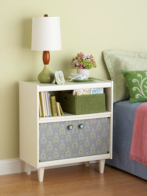 White nightstand with pattern doors