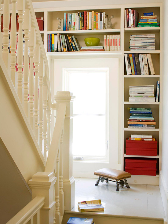 Book shelves on staircase landing