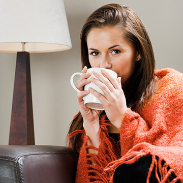 Woman getting cozy on couch