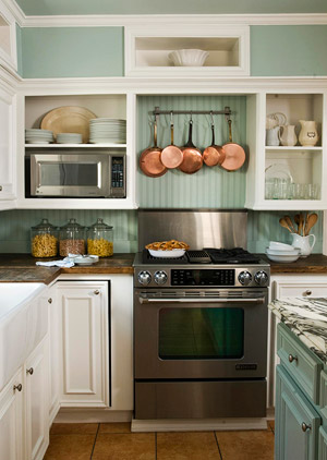Green and white u-shaped kitchen