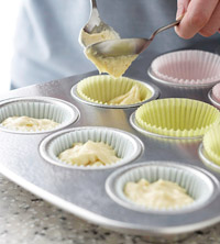 Filling muffin cups with cupcake batter