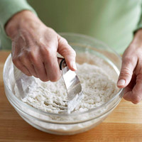 Cutting shortening into flour mixture