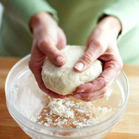 Forming piecrust dough into a ball