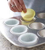Lining a muffin pan with paper bake cups