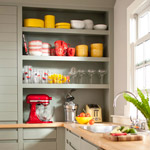 Appliances and dishes on open shelves