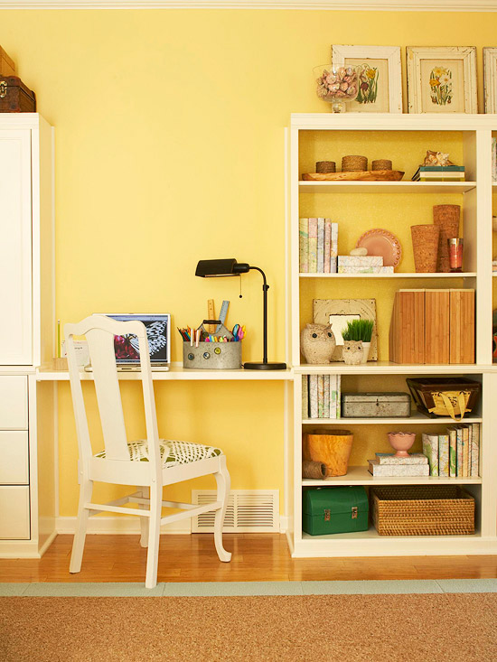 Desk with neutral bookcase, yellow walls