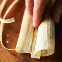 Rolling corn husk for tamales