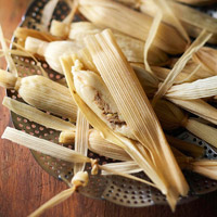 Cooking tamales in a steamer basket