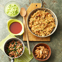 Mexican Rice, Pinto Beans, Salsa Verde, and Red Chile Sauce