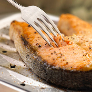 Testing salmon for doneness