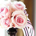 pink roses with pink striped ribbon centerpiece
