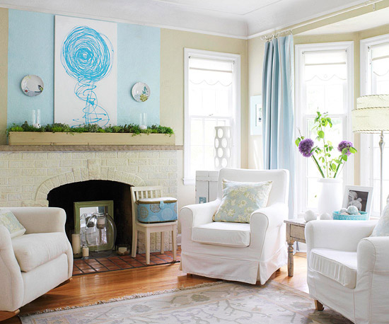 Living room with white furniture and blue accents