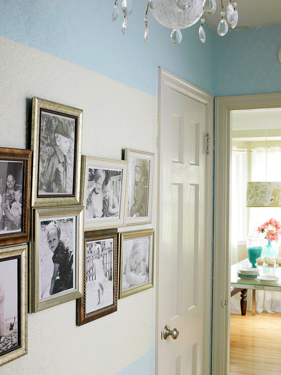 Framed photographs hung in hallway