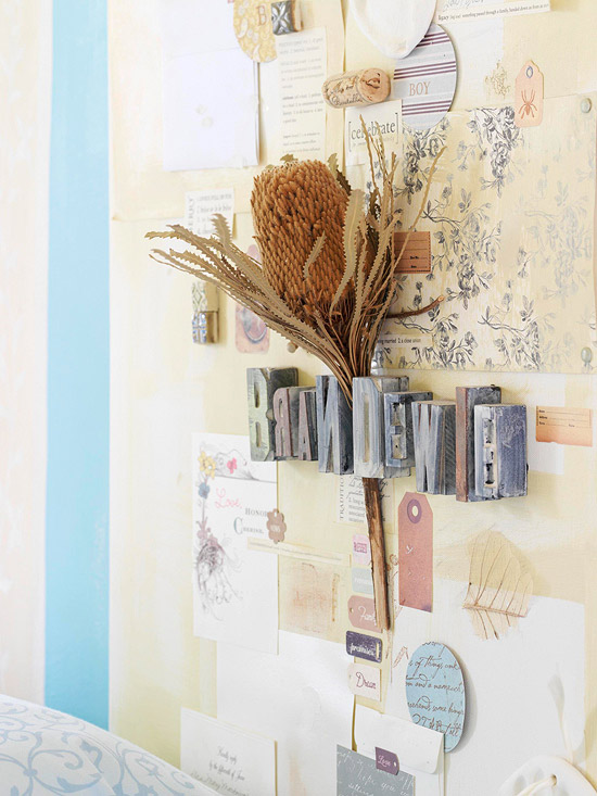 A collage serves as a headboard and is personalized with family mementos