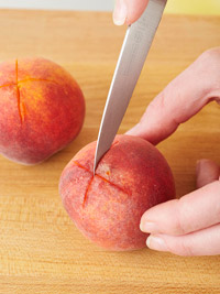 Cutting an X into a peach