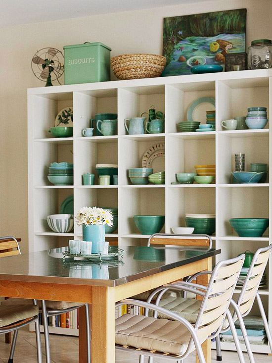 White shelves with blue pottery