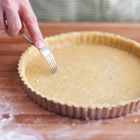 Pricking pastry with fork