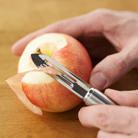 Peeling a strip from apple