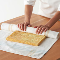 Cake being rolled in towel