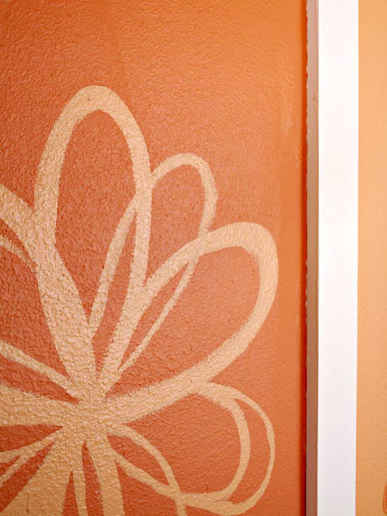 Orange flower painted on wall