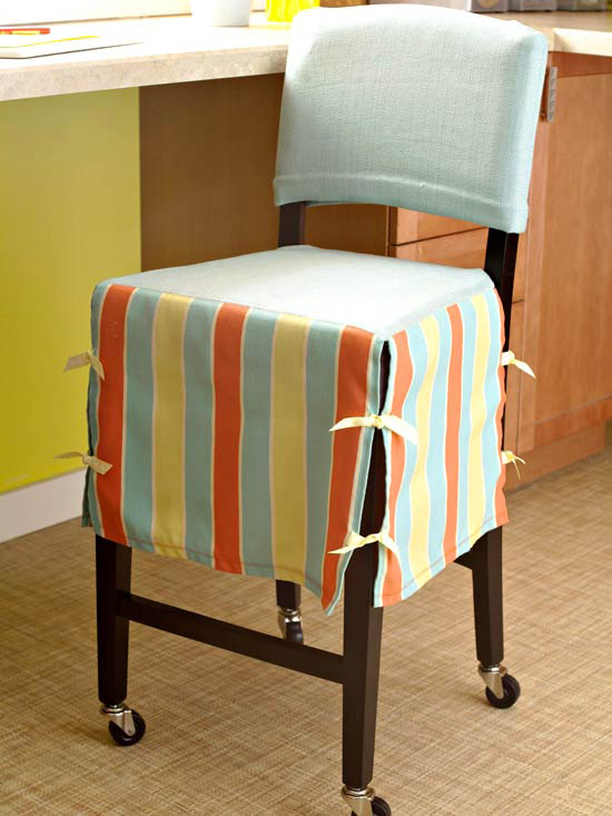 Blue chair cover with orange and yellow stripes