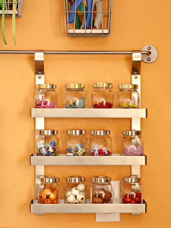 Craft supplies organized on spice rack