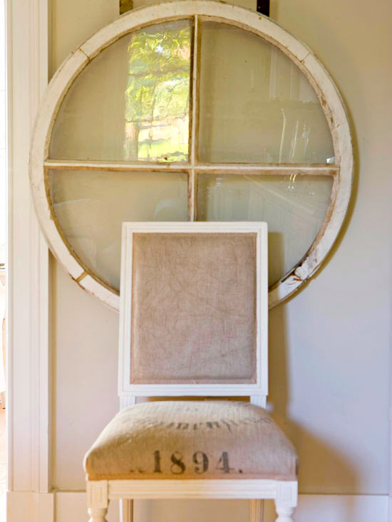 Unique arched windows used together to create a round for Using old windows as wall decor