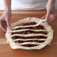 Laying strips over pie