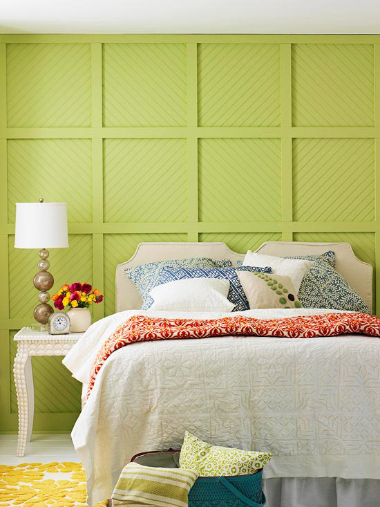 Bright green wall, white headboard