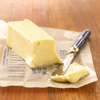 Softened butter stick and knife
