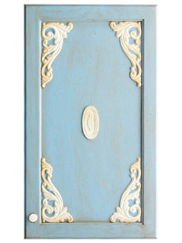 Blue cabinet door with cream wooden cutouts attached