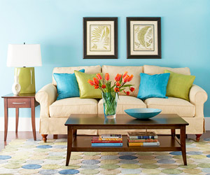 Sofa with blue, green pillows